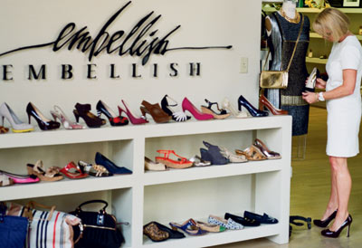 Terri Holley, at right, inspects a shoe in her Tennessee boutique.